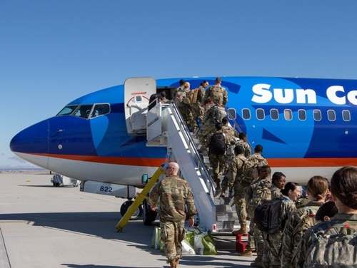 Troops from the 627th Hospital Center file onto a plane bound for Washington state on March 27, 2020. (Pfc. Ashton Empty/Army)