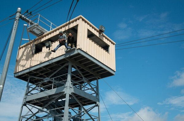Eric K. Fanning, acting under secretary of the Army, experiences firsthand the exhilaration and terror of exiting the 34-foot tower at Advanced Airborne School on Fort Bragg, N.C., Aug. 11. The 34-tower is utilized in airborne training to help refine the first point of performance in any successful airborne operation, a strong and vigorous exit from an aircraft in flight. Fanning visited the post to observe both conventional and special operations capabilities first hand and to discuss concerns of the individual soldiers and commanders. Fort Bragg is the home of the nation's premier rapid deployment ground force, capable of deploying with little to no-notice anywhere in the world in 18 hours. (U.S. Army Photo by Staff Sgt. Charles Crail/released)