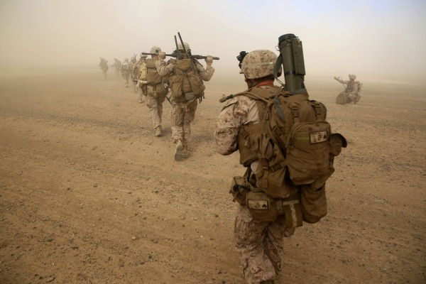 Marines with Weapons Company, 1st Battalion, 7th Marine Regiment, run to security positions after offloading from a CH-53E Super Sea Stallion helicopter during a mission in Helmand province, Afghanistan, April 28, 2014. The company's mission was to disrupt Taliban forces in Larr Village and establish a presence in the area. Five days prior to the helicopter-borne mission, the company confiscated two rocket-propelled grenades in the vicinity of the village.