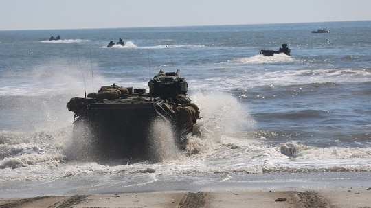 An Amphibious Assault Vehicle enters the water from Onslow Beach, Camp Lejeune, North Carolina, Oct. 5 during Type Commander Amphibious Training. (Capt. Clay Groover/Marine Corps)