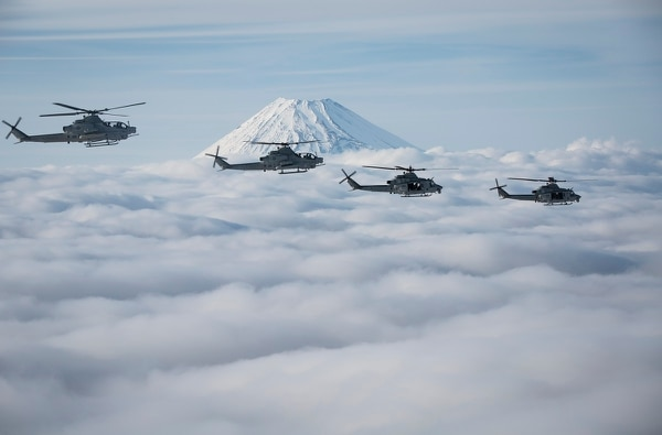 U.S. Marine AH-1Z Viper and UH-1Y Venom helicopters pass Mount Fuji in Shizuoka, Japan, on March 12, 2017. (Lance Cpl. Andy Martinez/U.S. Marine Corps)