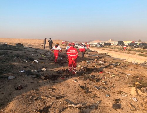Debris is seen from a plane crash on the outskirts of Tehran, Iran, Wednesday, Jan. 8, 2019. A Ukrainian airplane carrying at least 170 people crashed on Wednesday shortly after takeoff from Tehran's main airport, killing all onboard, state TV reported. (Mohammad Nasiri/AP)