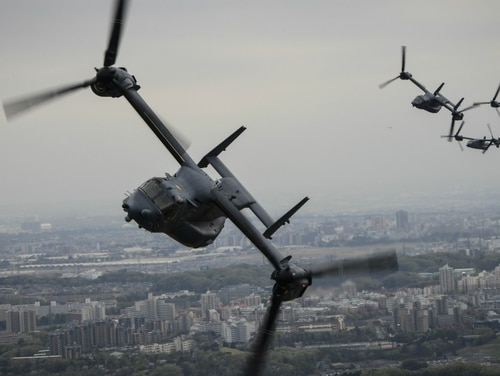 Four CV-22 Osprey tiltrotor aircraft assigned to the 353rd Special Operations Group, Detachment 1, fly above Tokyo, Japan, April 5. At least four Ospreys with the 353rd SOG landed in Vietnam Feb. 5 en route to exercise Cobra Gold in Thailand. (Senior Airman Joseph Pick/Air Force)