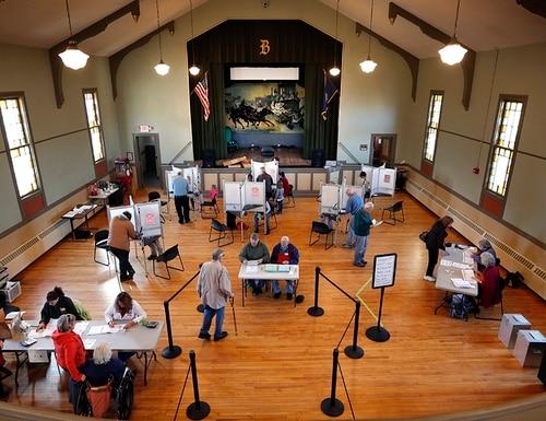 Voters cast their ballots at historic Holley Hall, Tuesday, Nov. 8, 2016, in Bristol, Vt. (Robert F. Bukaty/AP)