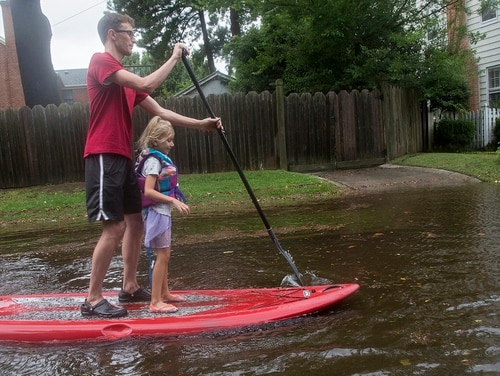Eric Young paddles through flooded streets in Larchmont with his daughter, Emily Ruth, 5, after Hurricane Dorian brought heavy wind and rain to Norfolk on Friday. (Kaitlin McKeown/The Virginian-Pilot via AP)