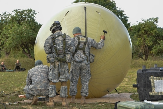 Soldiers adjust a GATR 2.4 meter antenna while setting up a tactical operations center during exercise Swift Response 15 at the U.S. Army's Joint Multinational Readiness Center in Hohenfels, Germany, Aug. 27, 2015. (Staff Sgt. Carol A. Lehman/Army)