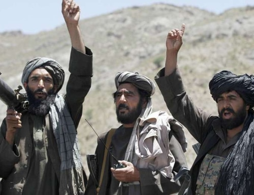 In this May 27, 2016 file photo, Taliban fighters react to a speech by their senior leader in the Shindand district of Herat province, Afghanistan. (Allauddin Khan/AP)