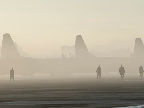 Airmen from the 374th Maintenance Group conduct a foreign object debris walk on the flightline at Yokota Air Base, Japan, Dec. 18, 2019. The 374th Medical Group has issued a public health warning to personnel and family members about the spread of a new virus from Wuhan, China. (U.S. Air Force photo by Airman 1st Class Brieana E. Bolfing)