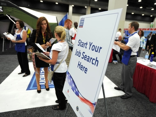 Staff from the Veterans Affairs' Employment Services Office take part in a hiring fair in 2012. (VA photo)