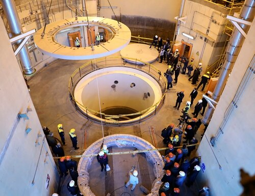 In this Dec. 23, 2019, file photo released by the Atomic Energy Organization of Iran, technicians work at the Arak heavy water reactor's secondary circuit, as officials and media visit the site, near Arak, Iran. (Atomic Energy Organization of Iran via AP, File)