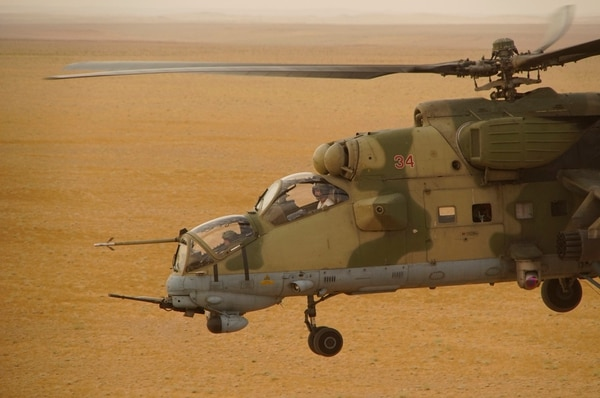 In this Friday, Sept. 15, 2017 photo Russian military helicopter flies over a desert in Deir es-Zor province, Syria. A U.S.-backed force in Syria said a Russian airstrike wounded six of its fighters Saturday near the eastern city of Deir el-Zour while in southeast Syria, Syrian troops and their Iran-backed allies began a new offensive aiming to capture areas along the Iraq border under the cover of Russian airstrikes. (AP Photo)