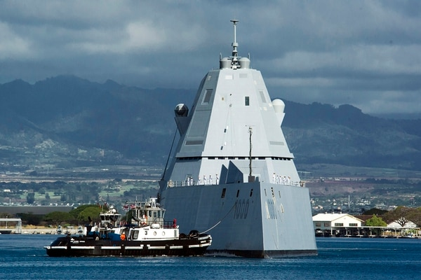 The destroyer Zumwalt arrives at Joint Base Pearl Harbor-Hickam in 2019, Delays with Zumwalt's combat system installation caused Congress to put pressure on the Navy to raise its standards for ship deliveries. (Craig T. Kojima/Honolulu Star-Advertiser via AP)