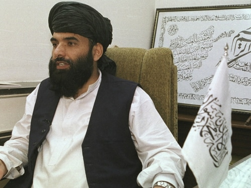 In this Nov. 14, 2001, file photo, Suhail Shaheen, then Deputy ambassador of the Islamic Republic of Afghanistan, gives an interview in Islamabad, Pakistan. Shaheen, a spokesman for the Taliban said Wednesday, Jan. 30, 2019, that they are not seeking a monopoly on power in a future administration in Afghanistan but are looking for ways to co-exist with Afghan institutions. (Tariq Aziz/AP)