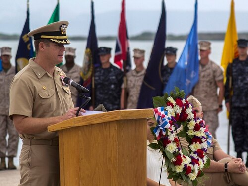 In this June 3, 2014, image, Navy Capt. John R. Nettleton, then-commanding officer of Naval Station Guantanamo Bay, Cuba, speaks during a Battle of Midway commemoration ceremony. Nettleton was arrested Wednesday, Jan. 9, 2018, on charges that he interfered with the investigation into the death of a civilian with whom he fought after an argument over whether the officer had had an affair with the man's wife. (Navy via AP)