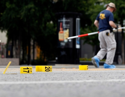 Investigators work in the area of downtown Dallas that remains an active crime scene, Saturday, July 9, 2016. Five police officers are dead and several injured following a shooting in downtown Dallas Thursday night. (AP Photo/Eric Gay)
