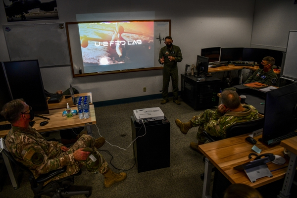 Gen. Mark Kelly, right, commander of Air Combat Command, and Command Chief Master Sgt. David Wade of ACC receive a briefing from U-2 Federal Laboratory staff about the organization's stand-up and recent projects, Dec. 4, 2020, at Beale Air Force Base, Calif. (Staff Sgt. Colville McFee/U.S. Air Force)