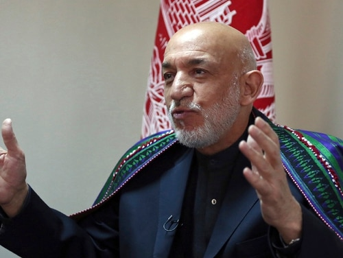 "Former Afghan President Hamid Karzai said Thursday, Nov. 1, 2018, that he sees a role for the Taliban in his country after the war in peacetime Afghanistan. Karzai also said that five Taliban leaders who were freed from the U.S. military prison at Guantanamo Bay in exchange for U.S. Army Sgt. Bowe Bergdahl are ""good individuals, good Afghans"" who should have a role in peace negotiations. (Rahmat Gul/AP)"