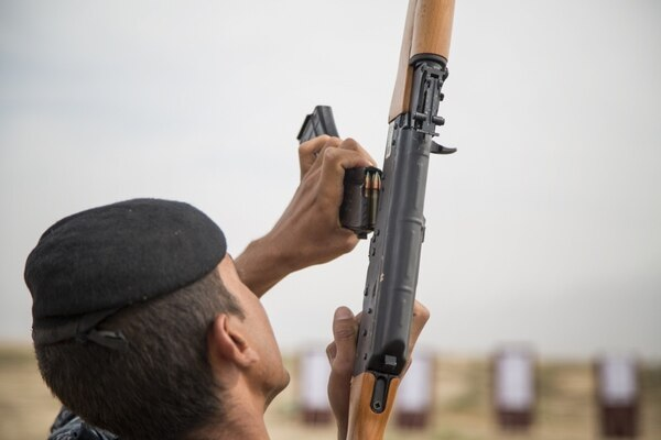 A member of the Iraqi security forces loads an AK-47 during short-range marksmanship training led by Spanish Guardia Civil at the Besmaya Range Complex in Iraq on May 23, 2017. (Cpl. Tracy McKithern/U.S. Army)