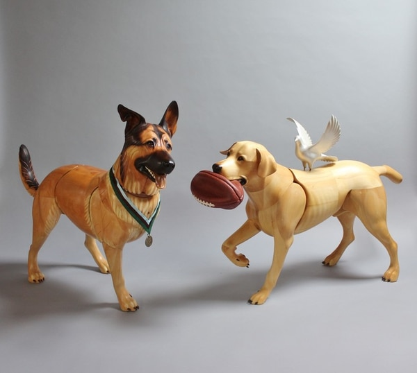 Lucca and Cooper were on assignment together in 2007 in Iraq. Between patrols, Lucca and Cooper snoozed together in shady patches or cavorted with a deflated football. (US Air Force)