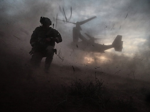 A soldier assigned to 10th Special Forces Group waits as an MV-22 Osprey approaches to conduct a medical evacuation in New Mexico. (Sgt. Nate Eroh/Army)