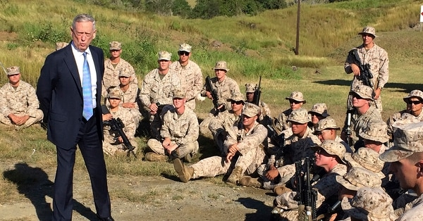 Defense Secretary Jim Mattis talks to U.S. Marine Corps troops at a rifle range at Guantanamo Bay, Cuba, on Thursday, Dec. 21. 2017. The unannounced visit was the first by a defense secretary since Donald Rumsfeld visited in January 2002 shortly after the first prisoners arrived from Afghanistan. (Robert Burns/AP)