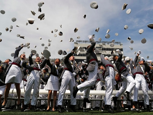 West Point graduates toss their caps into the air at the end of graduation ceremonies at the United States Military Academy, Saturday, May 26, 2018, in West Point, N.Y. (Julie Jacobson/AP)