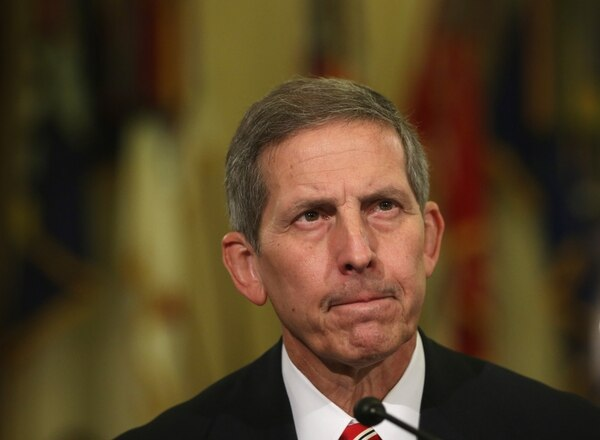 WASHINGTON, DC - JULY 24: Acting Veteran Affairs Secretary Sloan Gibson testifies during a hearing before the House Veterans' Affairs Committee July 24, 2014 on Capitol Hill in Washington, DC. The committee held the hearing on on