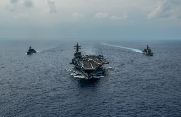The aircraft carrier Ronald Reagan, the cruiser Chancellorsville and the Akizuki class destroyer Fuyuzuki from the Japan Maritime Self Defense Force sail in formation while conducting a bilateral exercise in the Philippine Sea on Oct. 27. (Navy photo by: MC3 Codie Soule)