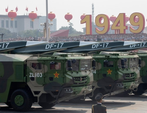 Chinese military vehicles carrying DF-17 ballistic missiles participate in a parade in Beijing on Oct. 1, 2019. The head of U.S. Strategic Command says he is keeping a close eye on all regions of the world. (Ng Han Guan/AP)
