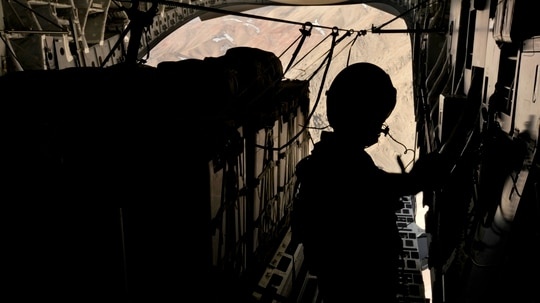 U.S. Air Force Tech. Sgt. Aaron Avery, a C-17 Globemaster III loadmaster from the 816th Expeditionary Airlift Squadron, prepares to drop supplies into Afghanistan on Feb. 26 in support of Operation Enduring Freedom. The Air Force is developing