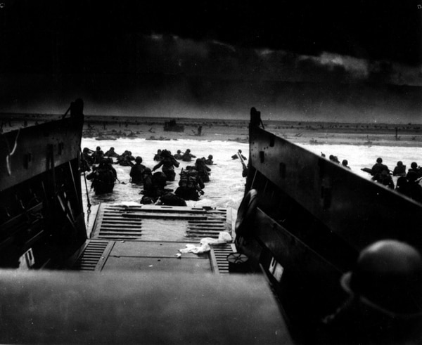 Soldiers hit the beaches of Normandy on June 6, 1944. (Robert F. Sargent/National Archives)