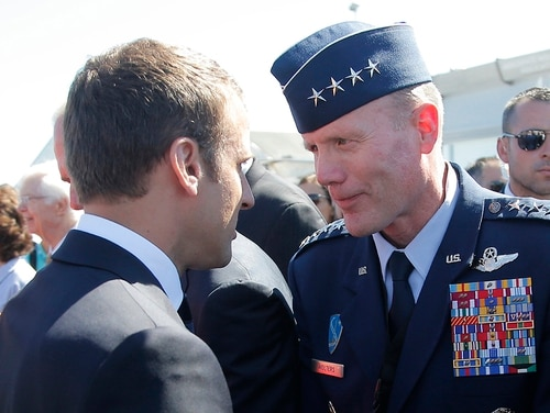 In this June 19, 2017, file photo, French President Emmanuel Macron, meets with Gen. Tod Wolters, while visiting the Paris Air Show in Le Bourget, north of Paris. (Michel Euler/AP, Pool)