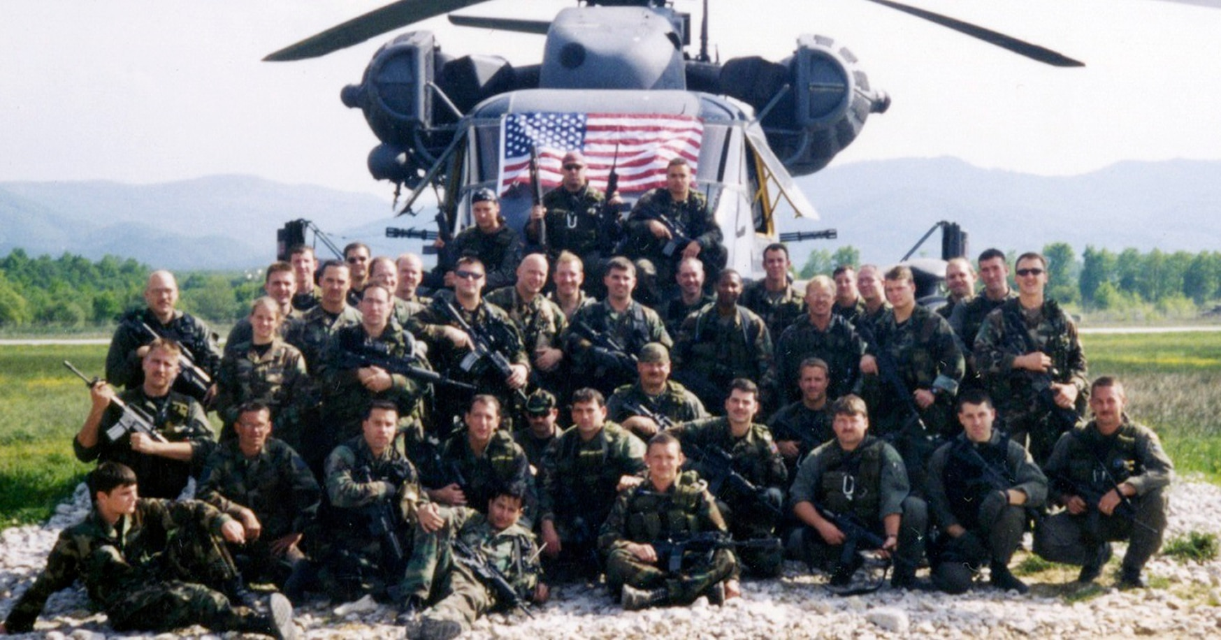 Special operations soldiers and airmen who took part in Goldfein's rescue pose in front of a helo at Tuzla Air Base, Bosnia. (Air Force)