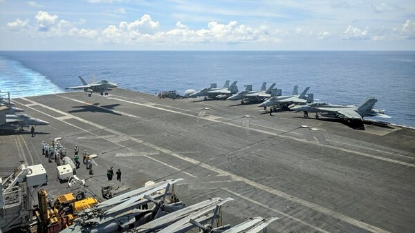 A U.S. Navy F/A-18 Super Hornet lands on the flight deck of aircraft carrier Ronald Reagan on Oct. 16, 2019, as it sails in the South China Sea on its way to Singapore. (Catherine Lai/AFP via Getty Images)