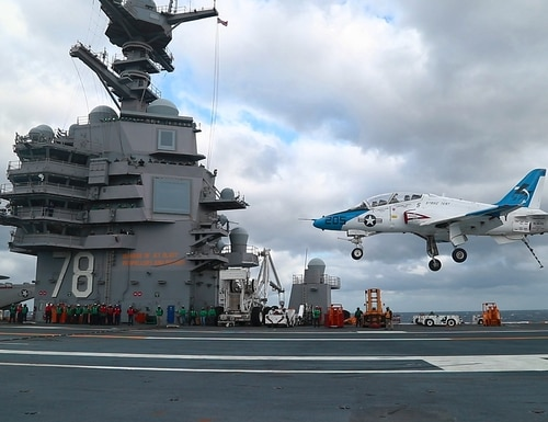 A T-45 Goshawk lands aboard the aircraft carrier Gerald R. Ford in January. (Navy)