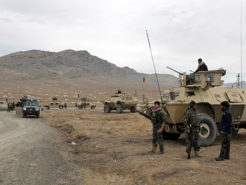 Afghan national army soldiers arrive at the site of a suicide bombing in Ghazni province west of Kabul, Afghanistan, Sunday, Nov. 29, 2020. (Rahmatullah Nikzad/AP)