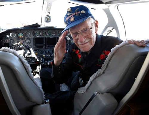 ADVANCE FOR WEEKEND EDITIONS OCT. 22-23 - In this Monday, Oct. 17, 2016 photo, Seated in the co-pilot seat, World War II pilot Frank Royal, 101, gets ready to take off on his