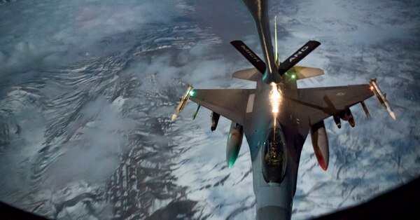 A U.S. Air Force F-16 Fighting Falcon refuels from a KC-135 Stratotanker assigned to the 340th Expeditionary Air Refueling Squadron over Afghanistan, Jan. 22, 2019. (Staff Sgt. Clayton Cupit/Air Force)