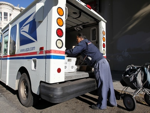 A task force plan to make the U.S. Postal Service more cost-effective proposes changing employee pay and retirement systems. (Justin Sullivan/Getty Images)