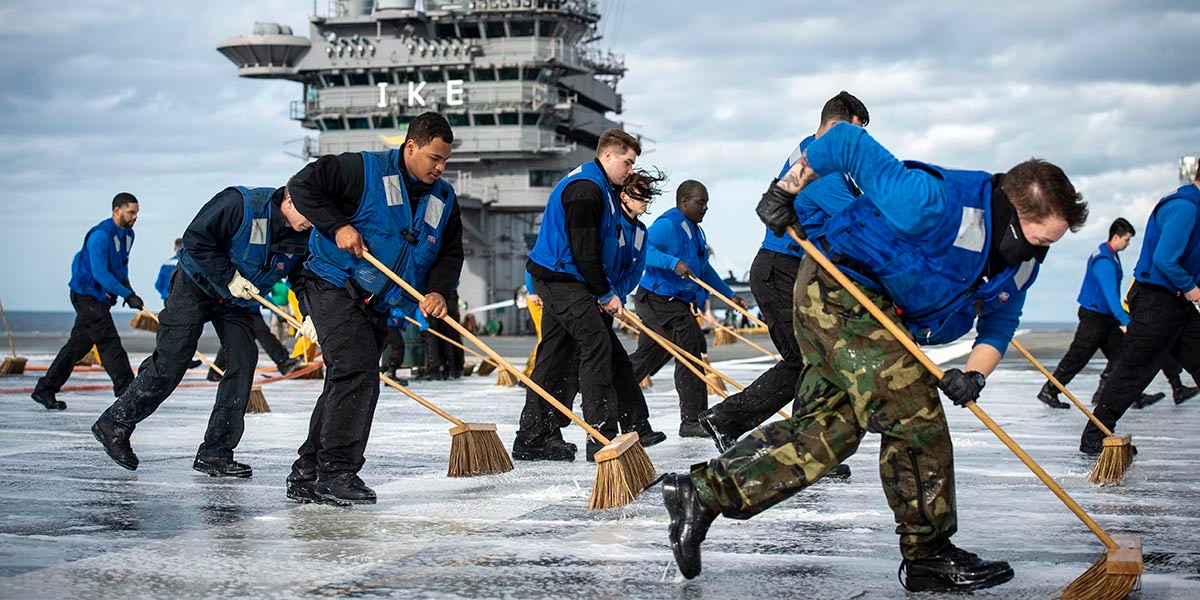 70473b1e912bf1 Sailors scrub the flight deck after a March 30 countermeasure wash-down  test on board the aircraft carrier Dwight D. Eisenhower.