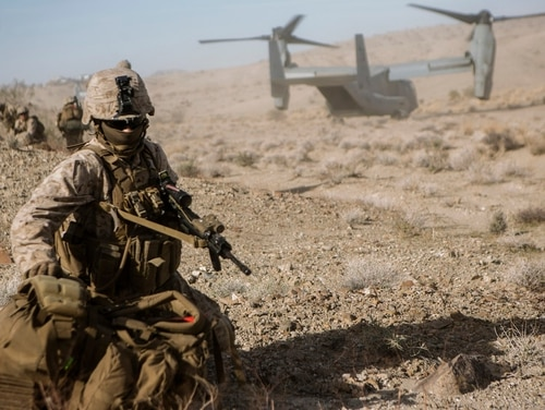 U.S. Marine Lance Cpl. James Johnson Jr. drops his load-bearing pack after extracting from an MV-22 Osprey for an Air Assault Course during Integrated Training Exercise 1-19 at Twentynine Palms, California. (Cpl. Timothy J. Lutz/Marine Corps)