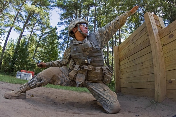 Pvt. Joshua Finau aims before throwing a hand grenade during basic training on Fort Jackson, S.C., Sept. 19, 2015. (Sgt. Ken Scar/Army)
