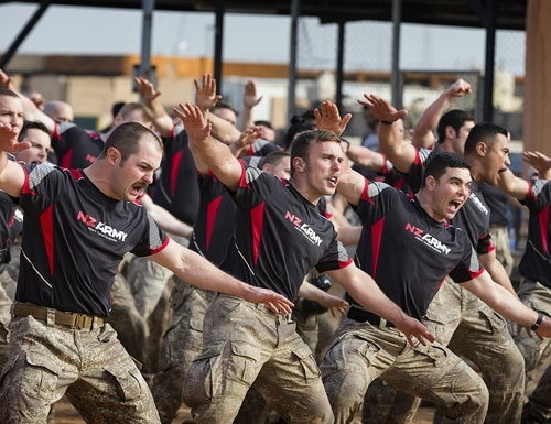 New Zealand Defence Force members perform the NZDF haka during the formal welcoming ceremony, a powhiri, to celebrate Waitangi Day 2019 at Camp Taji, Iraq, Feb. 6, 2019. (Cpl. Oliver Carter, New Zealand Defence Force/DoD)