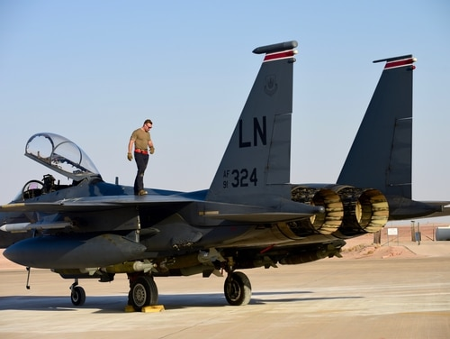 Staff Sgt. Zackary Suttles, a crew chief with the 378th Expeditionary Maintenance Squadron, conducts an inspection on an F-15E Strike Eagle at Prince Sultan Air Base, Saudi Arabia, Jan. 4. (Tech. Sgt. Michael Charles/Air Force)