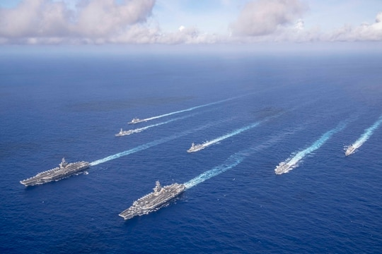 The Theodore Roosevelt and Nimitz carrier strike groups transit the Philippine Sea in formation while conducting dual carrier and airwing operations on June 23, 2020. (Mass Communication Specialist Seaman Dylan Lavin/Navy)