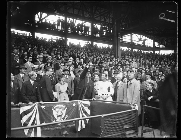 President Franklin D. Roosevelt tosses out the ceremonial first pitch to start the baseball season on April 14, 1936 in Washington, D.C. The hometown Senators were playing the New York Yankees, who were nicknamed the