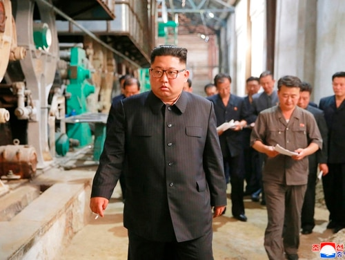 In this undated photo provided on July 2, 2018, by the North Korean government, North Korean leader Kim Jong Un, center, visits Sinuiju Chemical Fibre Mill in Sinuiju, North Korea. (Korean Central News Agency/Korea News Service via AP)