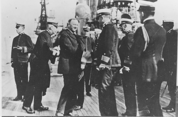 Secretary of the Navy Josephus Daniels (left center) is welcomed aboard the battleship New York by commanding officer Capt. Edward L. Beach in 1918. Behind Secretary Daniels is the Chief of Naval Operations, Adm. William S. Benson. Just behind Capt. Beach is Vice Adm. DeWitt Coffman. (U.S. Naval History and Heritage Command)