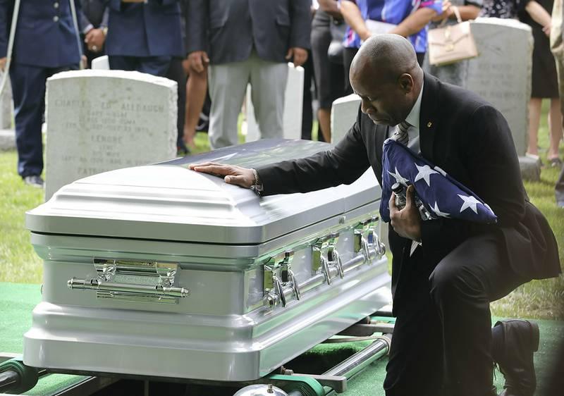 Christopher C. Morgan touches the casket of his son, West Point Cadet Christopher J. Morgan, during the interment ceremony at West Point, N.Y