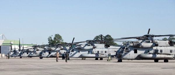 CH-53E Super Stallion helicopters with Special Purpose Marine Air-Ground Task Force - Southern Command standby on the flight line aboard Marine Corps Air Station New River, North Carolina, before departing for Soto Cano Air Base, Honduras, June 8, 2016. (Sgt. Adwin Esters/Marine Corps)